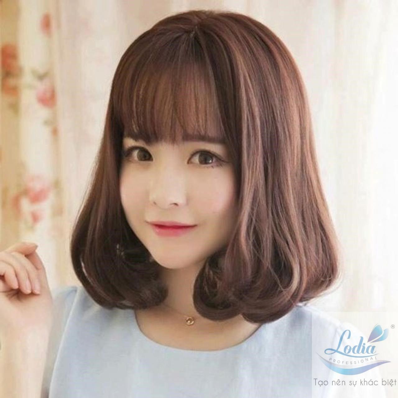 Kiểu tóc uốn xoăn nhẹ cho tóc ngắn